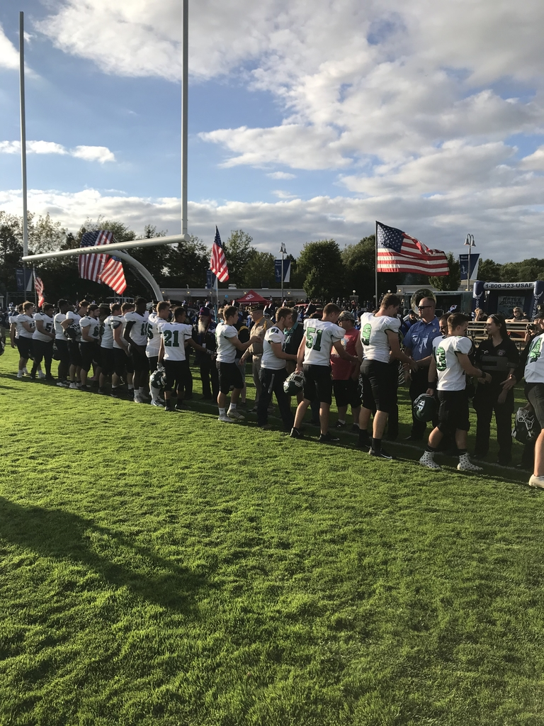 Varsity Football players thanking our veterans and first responders